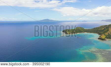 Tropical Islands With Beaches And Turquoise Sea Water. Seascape And Tropical Landscape. Sleeping Din