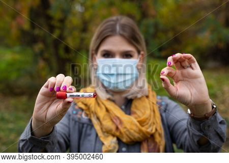 Beautiful Pregnant Woman In The Park Wearing Surgical Mask Because Of Covid-19 Global Pandemic. Thir