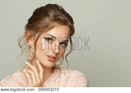 Fashion Beauty Portrait Of Natural Young Woman Face With Freckles Skin And Ginger Hair On White Back