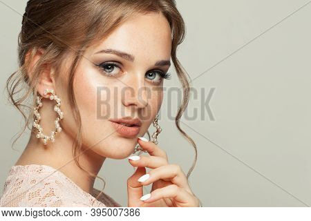 Beautiful Female Face. Pretty Woman With Ginger Hair And Pastel Color Makeup On White Background.