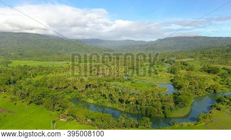 Aerial View Of Landscape With Farmland And Green Hills. Philippines, Mindanao. Rice Fields In Asia.