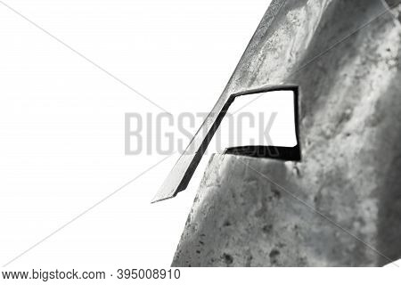 Closeup Of Ancient Iron Spartan Helmet Isolated On White Studio Background. Side View Of Medieval Ar