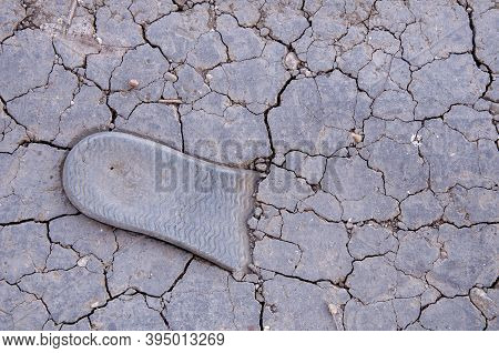 Drought Makes The Ground Barren, Texture Of Cracked Earth Close-up