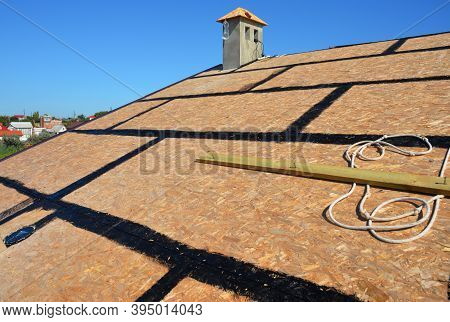 A Close-up On An Incomplete Roofing Construction On The Stage Of Roof Sheathing With Self-adhering R
