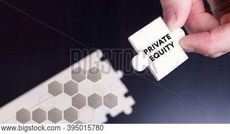 Business, Technology, Internet And Network Concept. Young Businessman Shows The Word: Private Equity