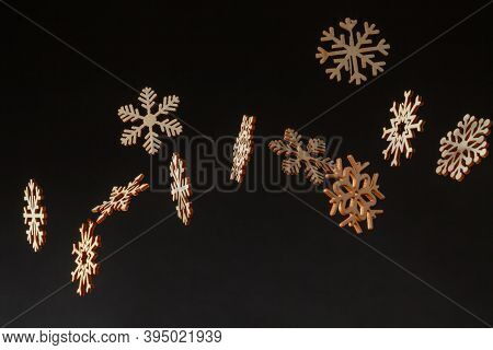 Falling Snowflakes Cardboard Cutouts In A Studio Photoshoot. Black Background With Text Space
