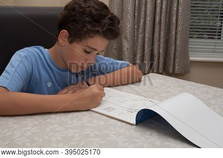 A British Teenage Boy Drawing A Picture Of A Seaside Town, Taken 13th Of August 2020 I Wool, Dorset,