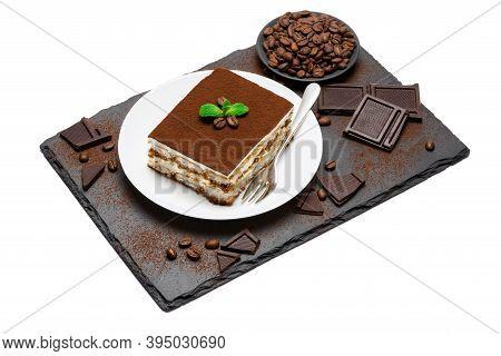 Traditional Italian Tiramisu Square Dessert Portion On Ceramic Plate, Pieces Of Chocolate Bar And Co