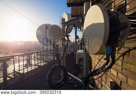 Radio Antennas With Outdoor Radio Unit And Power Cables, Coaxial Cables, Optic Fibers On The Metal C