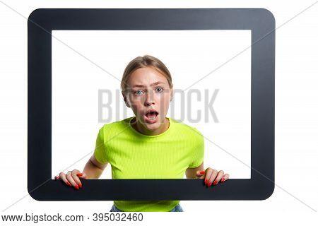 Indignant Girl Peeking Through Digital Tablet Frame