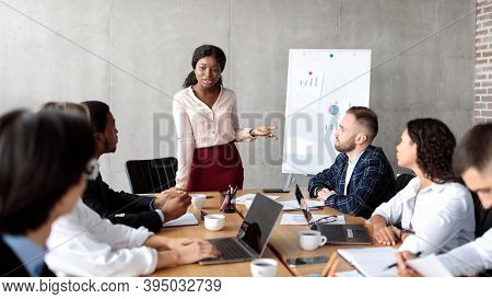 Business Presentation. African American Businesswoman Giving Speech During Corporate Meeting Present