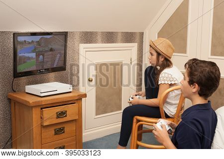 A Brother And Sister Play Minecraft On Their Xbox Together, Taken On The 13th Of August In Wool, Dor