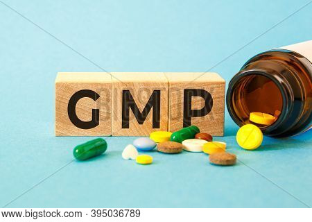 Gmp Good Manufacturing Practice - Inscription On Wooden Cubes
