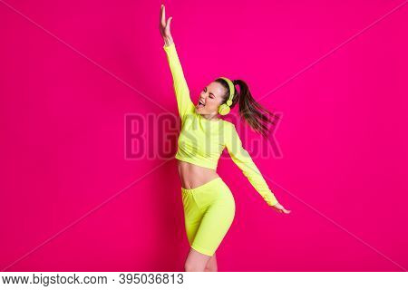 Portrait Photo Of Active Girl Wearing Headphones Sportwear Excercising Listening To Music Isolated O