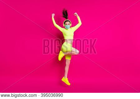 Full Length Body Size Photo Of Sportswoman Jumping Showing Strong Hands Wearing Mask Earphones Isola