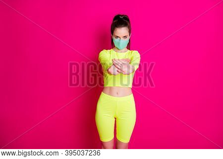 Photo Portrait Of Woman Wearing Facial Mask Showing Forbidden Wearing Yellow Sport Clothes Isolated