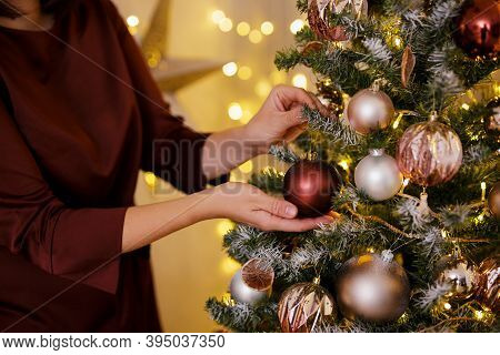 Christmas Tradition Concept - Close Up Of Beautiful Woman Decorating Christmas Tree