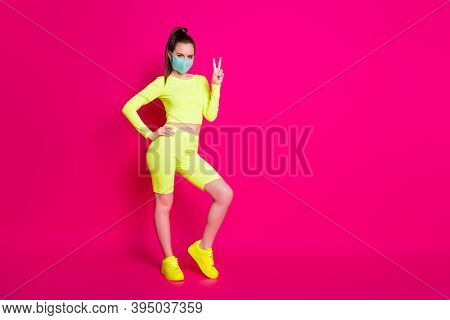 Full Length Body Size Photo Of Girl Wearing Sportswear Sneakers Showing V-sign Gesture Isolated On B