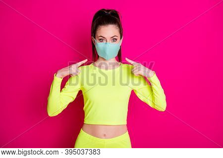Portrait Photo Of Girl Pointing At Medical Protective Mask Wearing Sportswear Ponytail Isolated On V