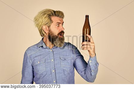 Having Alcohol Addiction And Bad Habits. Having Fun. Alcoholism Problem. Man With Tousled Hair Looks