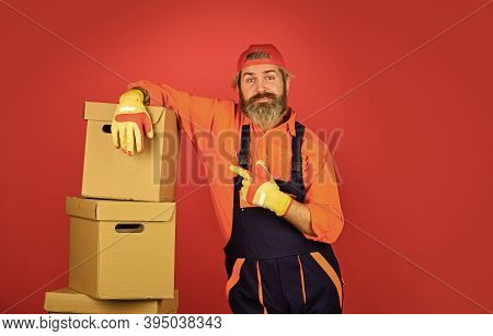 Moving Concept. Moving House Day. Think Outside The Box. Express Delivery Concept. Man Worker In Boi