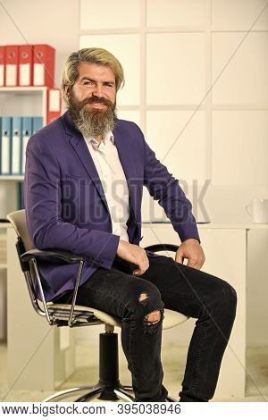 Sense Of Composure. Business Man Wearing Smart Casual Clothes. Handsome Man Sit In Office Chair. Por