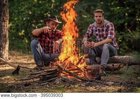 Pathways Into Nature. Hike And People. Two Men Relax At Fire. Hiking And Camping. Male Friendship. M
