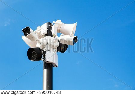 Cctv Cameras, Lights And Loudspeakers Are Mounted On One Pole Under Blue Sky