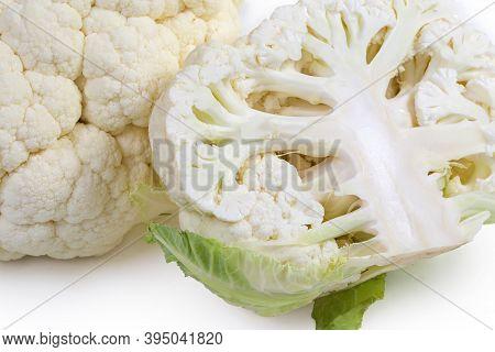 Half Of Fresh Cauliflower Head Against The Whole Cauliflower, Fragment Close-up