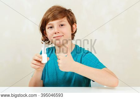 Sick Kid With Runny Nose Using Nasal Medicine Spray. Nasal Allergy. Kid With Ill Disease Treatment S