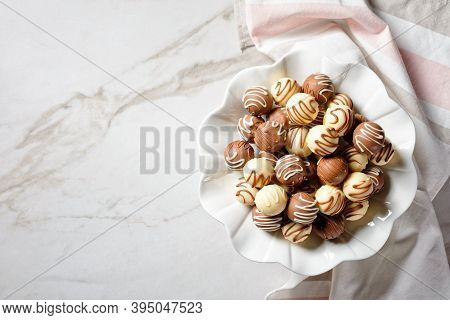 Chocolate Truffles Balls On A Platter On A Marble Table, Horizontal View From Above, Flat Lay, Free
