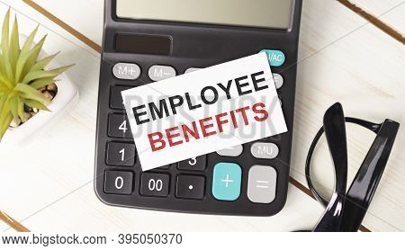 Text Employee Benefits On White Paper On Calculator, Business Concept