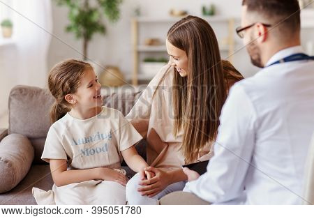 Happy Little Child Girl Patient With His Mother At The Reception Of A Friendly Pediatrician Family D