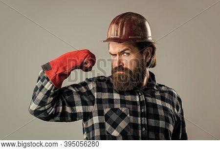 He Is Strong. Industrial Worker In Helmet. Man In Gloves. Construction Worker In Hard Hat. Engineer
