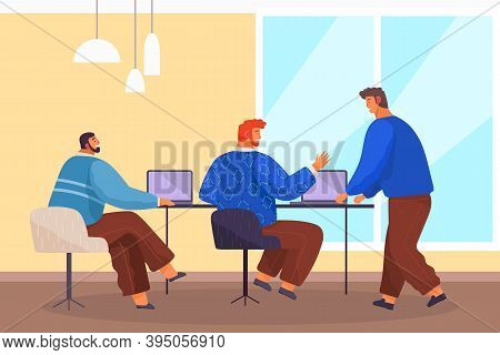 Men At The Table In Business Meeting In Office, Discussing He Project, Laptops On The Table. Modern