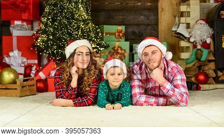 Parents And Child Christmas Eve. Parenthood Happiness. Happy Holidays. Father Mother Cute Son Christ