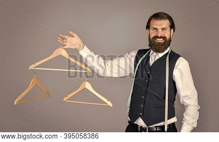 Best Design. Portrait Of Man Holding Hanger. Tailor Man Use Tape Measure. Professional Male Sartor W