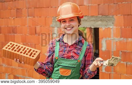 Architecture Construction Child. Child In Uniform Working Around Brick Wall. Labour Day Concept. Lit