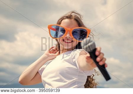 Lifestyle And People Concept. Make Your Voice Louder. Teen Girl Singing Song With Microphone. Having