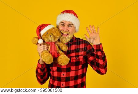 Kind Hipster With Teddy Bear. Christmas Spirit. Christmas Time For Mercy. Charity Project. Bearded M