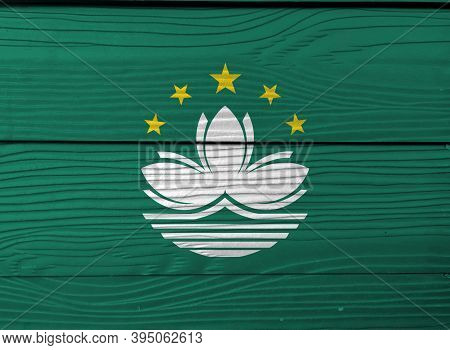 Flag Of Macau On Wooden Wall Background. Grunge Macau Flag Texture, Green With A Lotus And Stylised