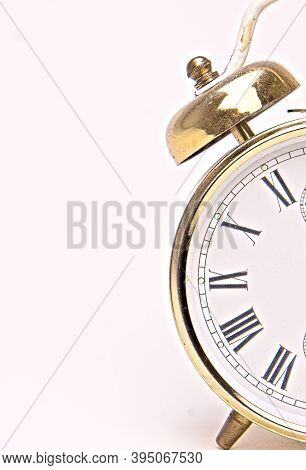 Old Alarm Clock With Classic Letters One Half Isolated On White Background.