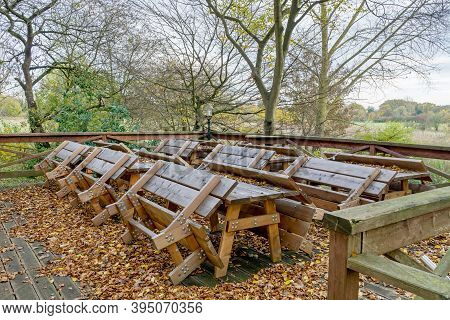 An Outdoor Seating Area Of A Cafe Restaurant With Tables And Benches Chained Up Due To Coronavirus L