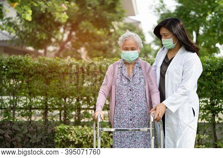 Doctor Help Asian Senior Or Elderly Old Lady Woman Walk With Walker And Wearing A Face Mask For Prot