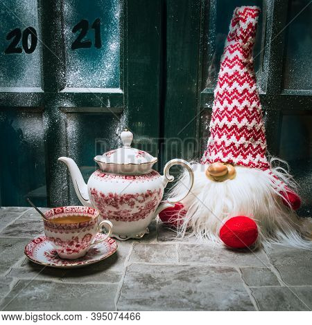 New Year's Eve, A Table With A Gnome And An English Tea Set.