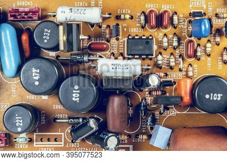 Resistors,capacitors And Other Electrical Components On Tv Circuit Board,macro Close-up