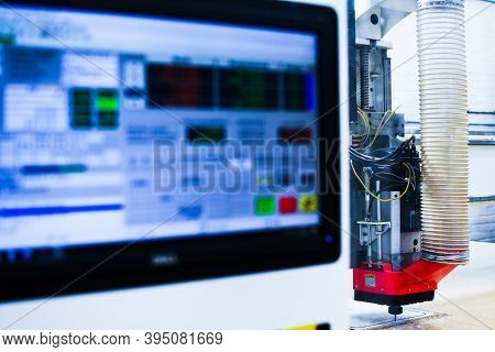 High Speed Plastic Cnc Machine Pictured With The Computer Screen In Foreground While Cutting Out A P
