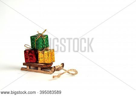 Sledge Loaded With Bright Christmas Gifts Isolated On White Background. Winter Holiday Concept. Imag