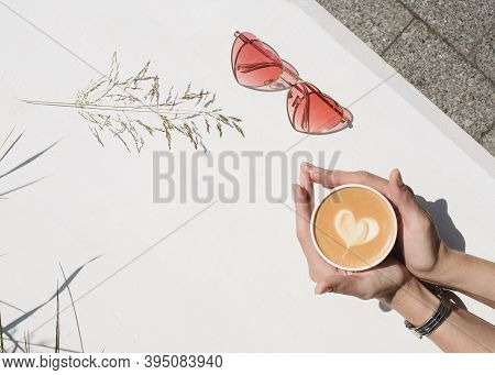 Woman's Hands Holding Cup Of Coffee Or Tea On A White Background. Top View Polystyrene Coffee Mug. O