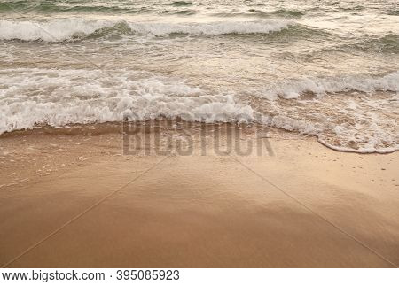 Evening Time Seascape Pastel Colors Background. Sandy Seashore With Rolling Waves. Selective Focus,